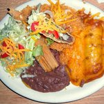 Combo plate with taco, enchiliada, chalupa, tamale, beans and rice.