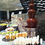 Dessert counter with chocolate fountain