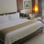 King size bed room with swimming pool access