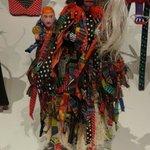 Costumed alebrijes on stilts