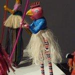 Close up of alebrije on stilts