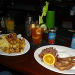 Sausage Omelet, Bloody Mary and Home Made Hass and Poached.