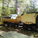 Old mining equipment by the parking lot.