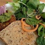 Fire & Brimstone quinoa ‐ kamut veggie burger served with mixed green salad w/