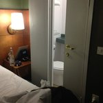 Silly bathroom doors too close to bed.