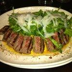 Sliced New York Strip with rosemary, lemon, cracked pepper, arugula, olive oil.  HIGHLY RECOMMEN