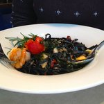 Black pasta, prawns, clam, mussels and vegetables