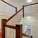 A wide staircase leads to the sleeping rooms upstairs.