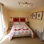 Master bedroom with en-suite jacuzzi bathroom at La Mirabelle
