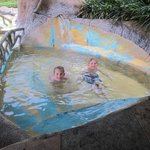 Kids in the warm, thermal pool