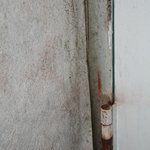 moldy dirty walls & rusty hinges on back of doors