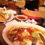 1/2 eaten super burrito & shrimp fajitas