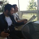 enjoying time out on the porch and reading their wine list