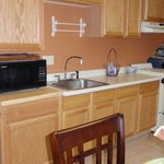 Suite kitchen: stove, coffee, microwave, refrigerator