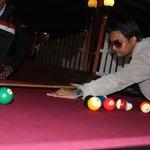 my friend siddharth/ playing pool at hottmillion2