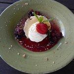 Refreshing lemon dessert with freshly picked berries