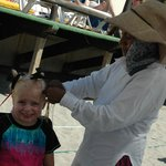 Our Daughter getting her hair braided by Lucy (vendor on beach)