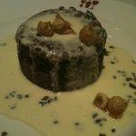 Hot fudge molten lava cake with hazelnut sauce
