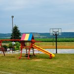 Swing set, basketball court, sand volleyball court, fire pit