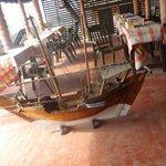 Restaurant area with a replica of a ship