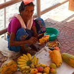 our friend fruit seller lady cutting fruits for us