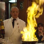 They flambé pancakes in the middle of the restaurant!