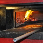 Our woodfire pizza. An icon since 1988.