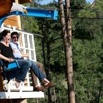 Couple having a great time on the Soaring Eagle Zipline at Rushmore Cave