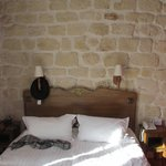 view of the bed - loved the exposed brick