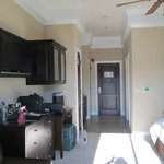 desk area; hallway with kichenette on left & bathroom on right