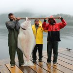 New friend Carol and her catch of the day with Captain Dave and dock hand Matt