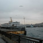 Ship crossing Bosporos and behide Galata bridge