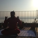 Yogateacher on the roof with view To Ganga!