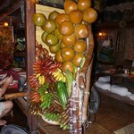 one of the pillar decorated with coconuts & bananas
