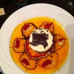 Chocolate mousse with feathery design in light peach syrup