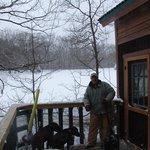 Marty shoveling snow form Maple Oak tree house deck