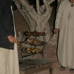 The cooked meat brought out from the underground oven