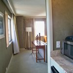 Coming from main bathroom past wet bar into suite