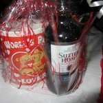 Mug with chocolates and small bottle of wine