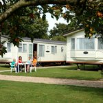 Enjoying the sun outside our holiday caravan.