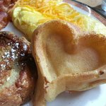 Playing suit waffle, french toast, bacon and made to order o