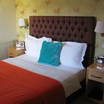 Nicely decorated bed area, room 11