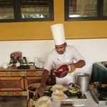 Chef preparing Egg hopper a must treat!