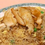 Our delicious chicken fried rice. It has extra chicken and gravy topping.