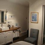 Vanity in the bedroom; glimpse of narrow en-suite