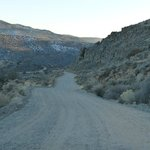 Dusty dirt road down into the gorge