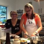 Kay supervising Deb with her culinary skills