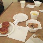 continental breakfast. Raisin bran, cinn rolls and orange ju