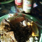 Jerk chicken, rice & beans, plantain, cole slaw, a small piece of a beef patty