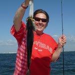 It's a keeper!  Fishing trip. Nice trout!